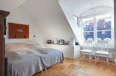 Interior:Gray Blanket In The Double Size Bed And The Picture On The White Wall Also White Cupboard With Many Art Decor Homey and Exclusive A...