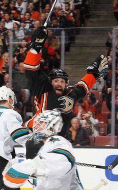 Patrick Maroon #19 of the Anaheim Ducks raises his stick to celebrate an assist to Rickard Rakell #67 against the San Jose Sharks