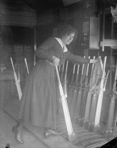 THE EMPLOYMENT OF WOMEN IN BRITAIN, 1914-1918  A signal woman operating levers in a railway signal box for the Great Eastern Railway Company at London Liverpool Street station