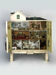 Dollhouse in cabinet