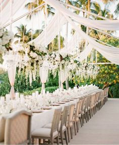 Disguise a wedding tent venue by draping fabric around the frame for a glamorous effect.