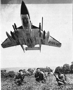 Royal Navy Fleet Air Arm de Havilland Sea Vixen on low pass for ground support, for the pongos.
