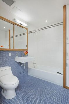 Blue floor and walls, white shower
