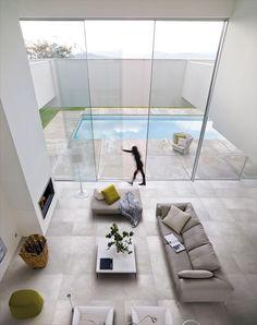 Minimalist-interior-design-with-stone-floor: Living Rooms, Floors, Dream, Interiors Design, Windows, Interiordesign, Architecture, Glasses Doors, Sliding Doors
