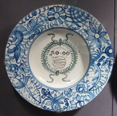 This 1699 dish comes from the Odler workshop in Dechtice, Slovakia. The Odlers were a family of craftsman who had converted to Catholicism from the Anabaptist community. This is one of their well known blue and white wares. It is today located in the Koerner European Ceramic Gallery of UBC's Museum of Anthropology in Vancouver, Canada.