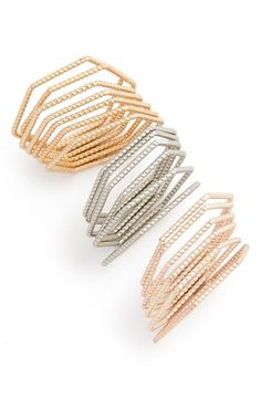 Stick to one color or mix it up for a striking tri-tone look with this set of thin bubble-textured rings from Topshop.