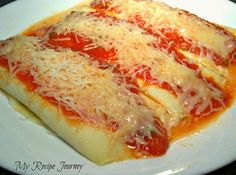 Homemade Manicotti...so delicate they melt in your mouth!