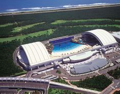 SeaGaia – Ocean Dome (or if you'd like, Japan's Indoor Man-Made Beach) in Miyazaki, Kyushu Island. It's listed in the Guinness Book of World Records as the world's largest indoor water park, measuring 300 meters in length, 100 meters in width. And the temperature is 30 degrees Celsius year-round. The dome has the largest retractable roof in the world, which also provides a simulated blue sky even when it's raining cats and dogs outside.