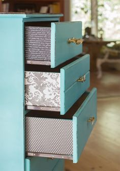 scrapbook papers on the sides; A chalk paint dresser makeover | Jenna Sue Design Blog