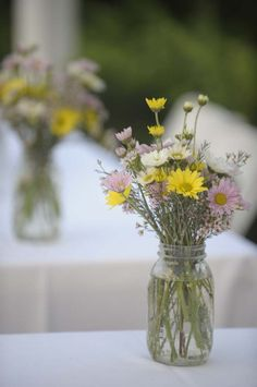 Mason jar with daisies with a little green...do we pull in pink?
