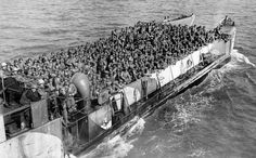 American troops pack a landing craft underway to a beachhead at the northern coast of France, during the Allied invasion of Normandy, June 19, 1944.