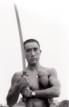 On this day World-renowned Japanese writer, Yukio Mishima commits ritual suicide by seppuku after failing to win public support for his often extreme political beliefs. Book Writer, Book Authors, Japanese Men, Japanese Culture, Poses, Samurai, Japanese Lifestyle, Such Und Find, Writers And Poets