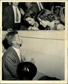 John F. Kennedy talking to his wife, Jackie, and sister, Eunice, at the 1956 Democratic Convention.