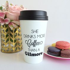 """""""She Drinks More Coffee Than A Gilmore"""" This travel mug is perfect for Gilmore Girl fans and just general fans of drinking copious amounts of coffee. Oy with the poodles already! Take your sense of adventure, huge collection of books, and copious amounts of coffee on the go! Remember to speak quickly and with wit because you've got places to go and people to see! (Click the photo to purchase your own mug from The Trendy Sparrow - $20)"""