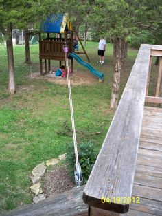 "pulley system with bucket that goes from our deck to the ""tree house""-- also serves as a clothesline #backyardplayhouse"