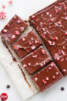 Food Photography Festive Peppermint Nanaimo Bars A traditional Canadian treat dressed up with a festive twist! We've kept the Nanaimo bar's classic, with a chewy base and creamy custard filling, but added a splash of peppermint for the holidays. Noel Christmas, Christmas Goodies, Christmas Candy, Christmas Desserts, Holiday Treats, Christmas Treats, Christmas Recipes, Holiday Appetizers, Holiday Recipes