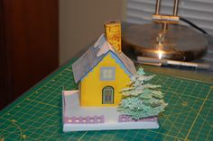My first Putz glitter house. Plans and information on these German style Christmas house can be found at http://www.cardboardchristmas.com/html/building_glittered_putz_houses.html,  The tree is from a Cricut Do it now project.