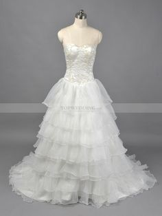 Ivory Sweetheart Appliqued Satin Ball Gown with Ruffled Organza Overlay