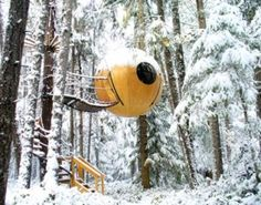 Suspended spherical treehouse in Canada