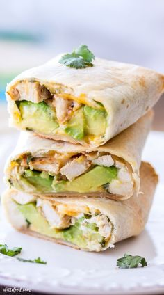 These easy Baked Avocado Chicken Burritos are made with Mission Gluten Free Tortillas chicken avocados cheese sour cream and cilantro then baked to perfection. The perfect weeknight dinner or quick and easy lunch! Chicken Avacado Burrito, Chicken Avocado Wrap, Chicken Burritos, Baked Burritos, Easy Appetizer Recipes, Wrap Recipes, Easy Dinner Recipes, Baked Avocado, Avocado Recipes