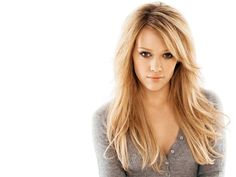 Hilary Duff - Long Layered Haircuts With Side Swept Bangs For Straight Hair