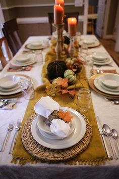 Traditional Harves Thanksgiving Table seating.  White dishes, gold runner, pillar candles, pumpkins. Classic, simple, easy!  #thanksgiving #decor #harvest #tentablesofthanks