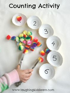 Counting activity for kids using pompoms. Using tongs can strengthen the hand muscles for future writing!