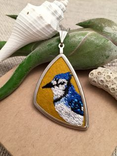 hand embroidered blue jay pendant