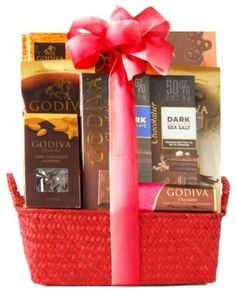 Godiva Dark Chocolate Gift Basket #valentineday #easter #xmass #xmas         Decadent gift basket featuring luxurious dark Godiva chocolate for holiday giving      Contains Godiva's dark chocolate gems, almonds, mint tablet, sea salt tablet, and more      Hand-crafted gift comes in a seagrass tray, finished with a hand-tied bow      Please note: colors vary--may include red or brown      Ships in Certified Frustration-Free Packaging