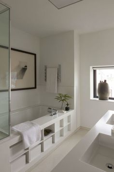 """4. Invest In Art  """"The bathroom is a place for reflection and relaxation. Finding the right piece of art will set the mood for your day."""""""