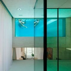 A rooftop swimming pool with a glass floor cantilevers out beside the entrance to this house by Dutch office Wiel Arets Architects