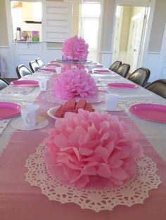 tables with paper flowers | inexpensive party decor idea | tissue paper pom pom decor idea