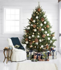 Fluffy ornaments that recall pheasants and feather boas, pinecones lit from within, white porcelain globes, and origami-like poinsettias: These babies do rustic in a very refined way.  Plus: Everything you need for a naturally elegant Christmas