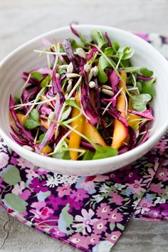 Red cabbage, part of the cruciferous family, is twice as effective at fighting cancer as other vegetables. Here it's a raw salad with mango and sprouts. I'd recommend radish sprouts for the bite (plus I hate alfalfa!).