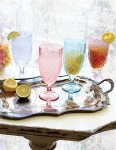 Lest anyone mistakenly drink your iced tea, hand crafted colored crystal glasses are cast in a radiant palette of blushing jewel tones.