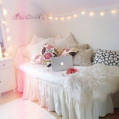 Dorm room idea bed as chair with a lot of pillows (furry, white, sparkly, words)