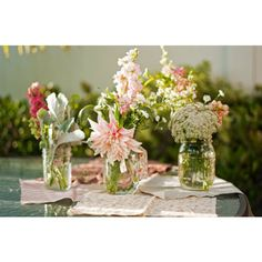 jam jars with blush pink and white flowers
