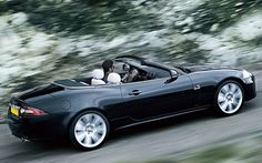 Jaguar XK  -  Slightly more relaxed than the 911, but almost as quick, the Jaguar XK swaps a flat-six engine for a 5.0-litre V8. If you'll settle for an older model you can have supercar style for a supermini budget. Just watch out for those running costs...