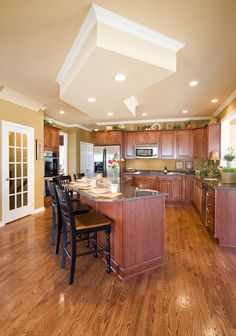 Large eat-in kitchen with beautiful island with granite countertop