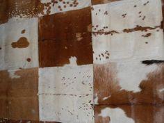 Multifarget teppe av firkantede skinnelementer