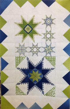 I like the unusual layout and colors.  Wonderful quilting.  No quilt maker is identified and this quilt does not appear on the link.