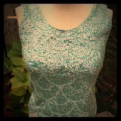 Vintage Seafoam Green Top Ultimate vintage. From the mid 60's. Made in Hong Kong. 100% wool shell covered in sequins, beads and more dangling beads for the bottom fringe. Don't be put off by it being wool because it is lined and is very comfortable. You feel amazing wearing this, at least I always did.  Sweaters