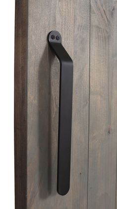 The Concord Pull is a flat sliding barn door handle with a smooth-cornered bend, resembling a machinery lever. Customize your barn door with Rustica Hardware! Gate Handles, Barn Door Handles, Sliding Barn Door Hardware, Sliding Door Systems, Sliding Doors, Welcome Signs Front Door, Black Interior Doors, Door Detail, Traditional Doors