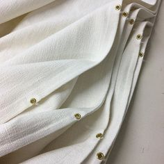We love a good #grommet here at DROP. Very large unlined #linen #romanblinds on the table today #Curtainmaker #propertysevelopment #interiordesign