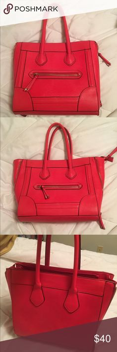 """Red tote purse Red tote bag from Aldo. Has the Celine bag style. Has no apparent scuffs or scratches. Clean on the inside. All zippers work. It was an impulsive buy and never wore bag but maybe once! I included all pics to answer dimension questions. 15"""" wide 20"""" tall including handles. Aldo Bags Totes"""