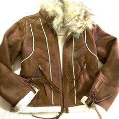 """Andrew Mark Faux Sheepskin Jacket & Coyote Collar Fab jacket by Andrew Marc 'Marc of New York'. Gently loved and EUC. Warm but not heavy in weight. Super sexy!! Collar stands or wear it down. Nice zip detail on cuffs and pockets. Jacket Length back of collar to hem 22"""".  Sleeves 24"""". Pit to pit 19"""". Tag says Petite but fits a true small. It's a stunner!!! Andrew Marc Jackets & Coats"""