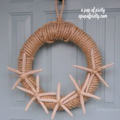 DIY Starfish Wreath - I could see doing this but using big shells on one side instead.  The conch shells (sp?) are what I'm thinking of. and maybe some sea glass or glass globes in the same colors too.