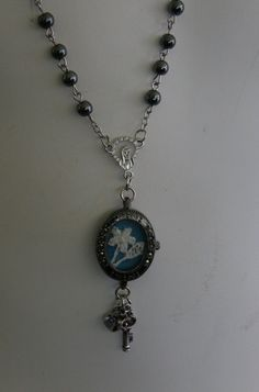 Assemblage Necklace From Marcasite Watch Case, Antique Lace, Rosary Beads and Charms on Etsy, $15.95