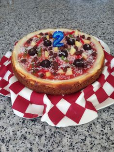 Pizza Party Birthday Cake... My very first cheesecake! All toppings make out of sweets, fruit and candy. :)