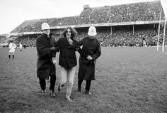 Police apprehending an anti-apartheid demonstrator during a rugby game, 1970